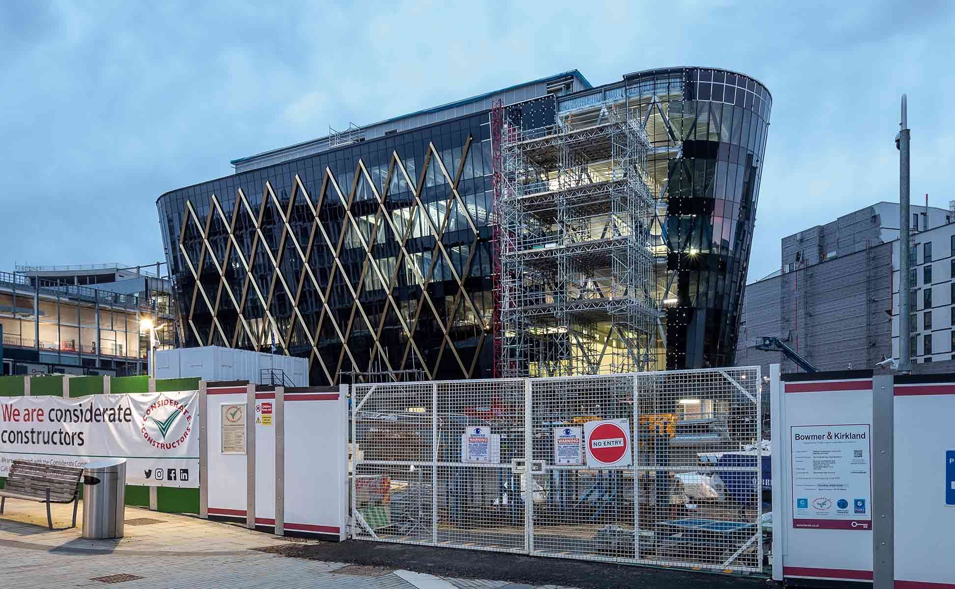 Construction photography showing glazing and diagram being installed on the National Innovation-Centre Newcastle