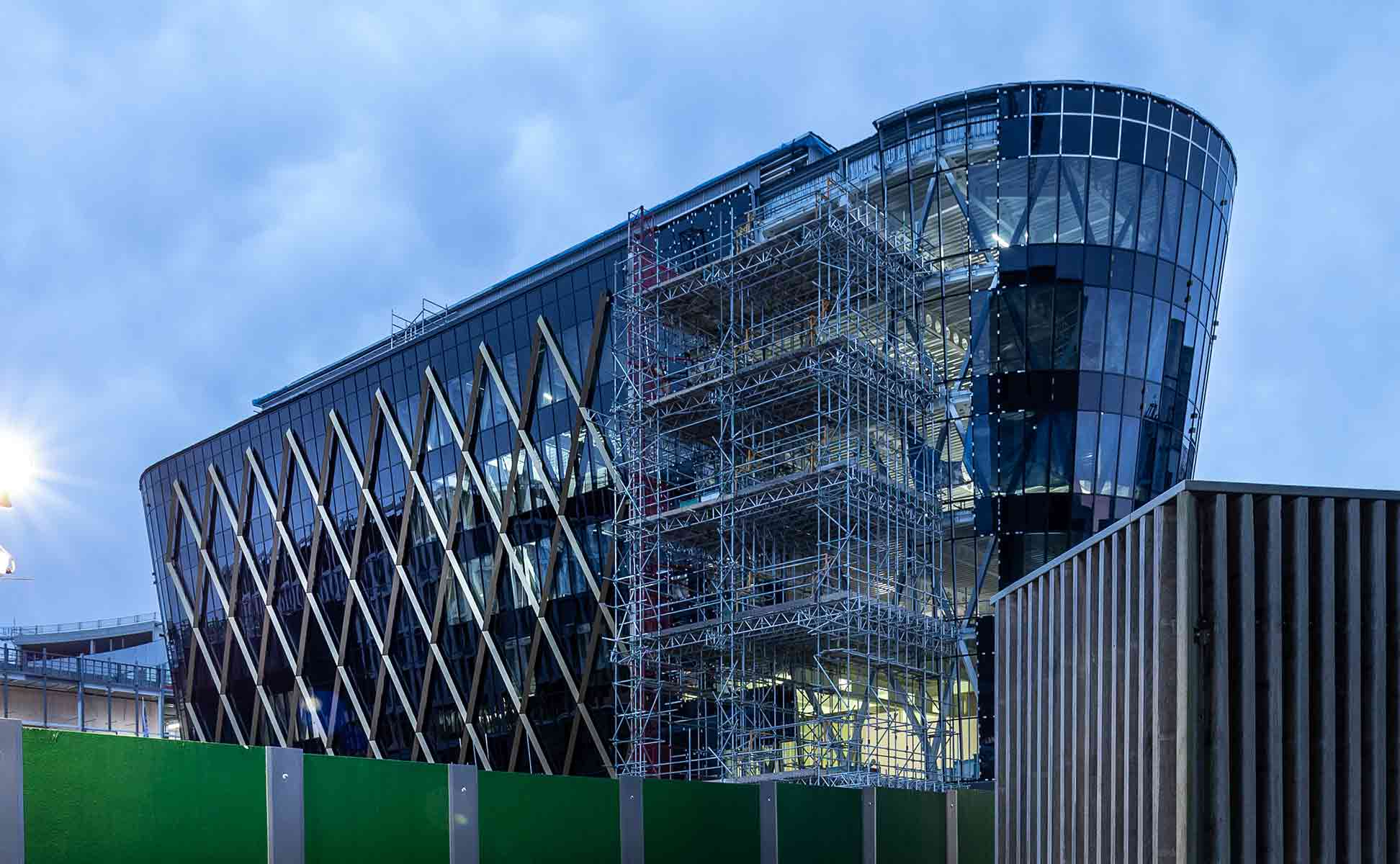 Construction photography showing glazing and diagrid  being installed on the National Innovation-Centre Newcastle. Taken by James Thompson.