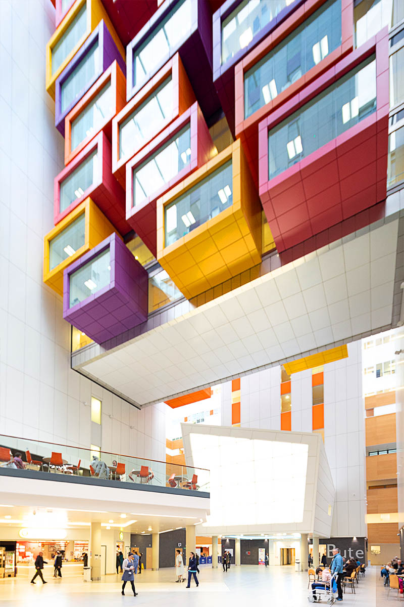 Architectural photograph showing brightly coloured cantilever pods in Queen Elizabeth University Hospital in Glasgow