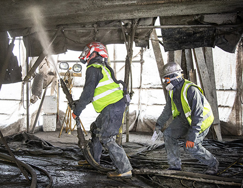 Construction photography showing concrete spraying to renovate underside of old brisge at Guardbridge Scotland.