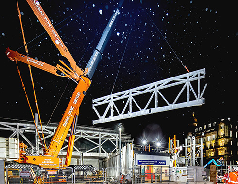 Construction photography showing large crane lifting 90te truss during construction of extension of Queen Street Railway Station Glasgow