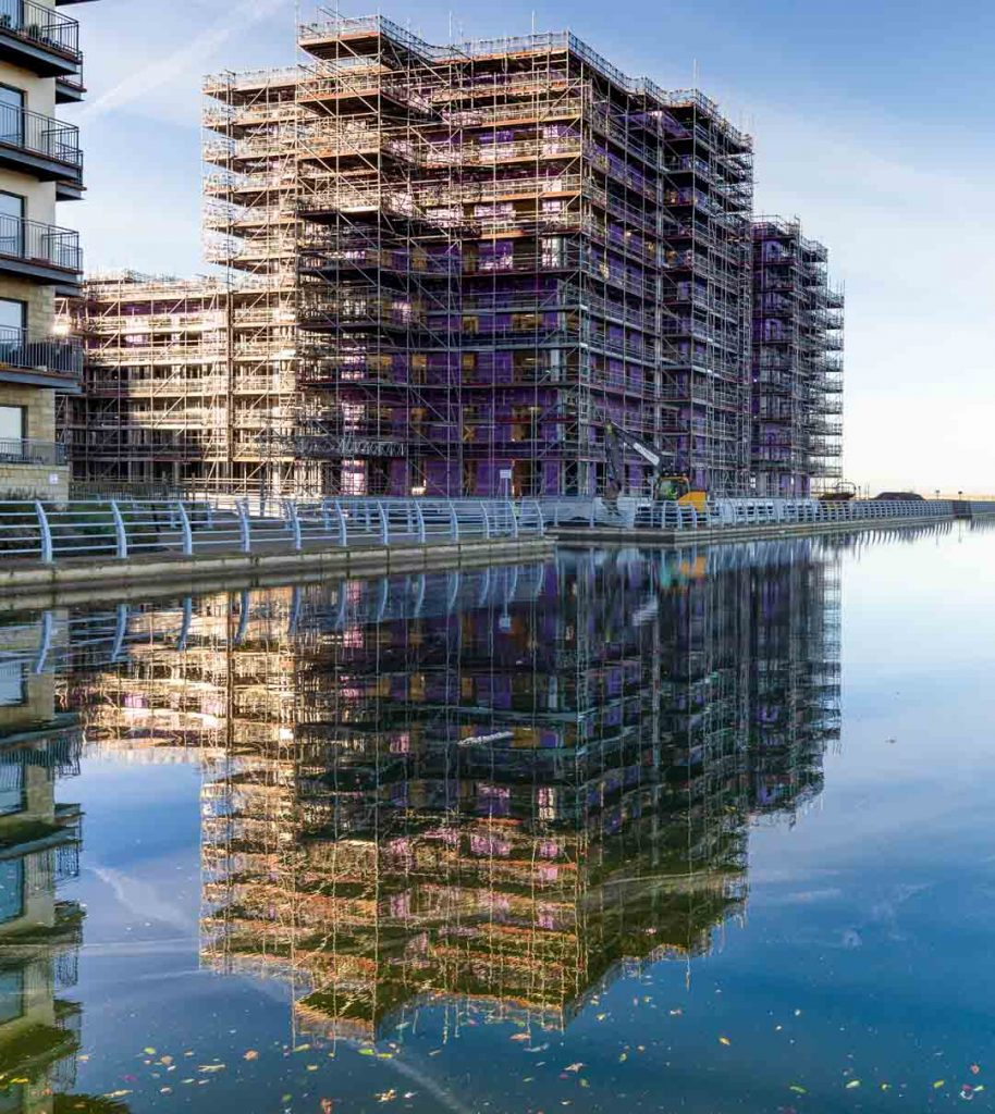 water reflection of construction of plot 27 Granton Harbour Edinburgh photography by James Thompson of Uk Construction Photography