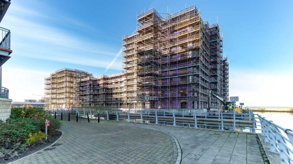 view from canal of steel structure construction of plot 27 Granton Harbour Edinburgh by James Thompson of Uk Construction Photography